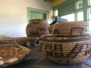 Native American baskets sitting on a table