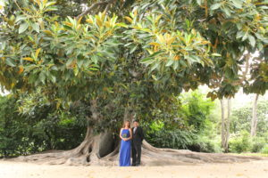 Taken almost 30 years to the day, Kirsten and NEED NAME returned to Rancho Los Cerritos to take a few photos in their favorite spots around the site, including in front of the Moreton Bay Fig.