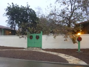 Rancho Los Cerritos hosts Christmas Candlelight Tours on Saturday, December 14, 2019. (Image is of RLC adobe gate to enter to courtyard with lantern lit)