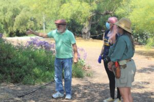 Steve points out an archeological dig site to Eileen and Marie